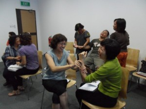 Participants have fun practising Meridan Massage Techniques